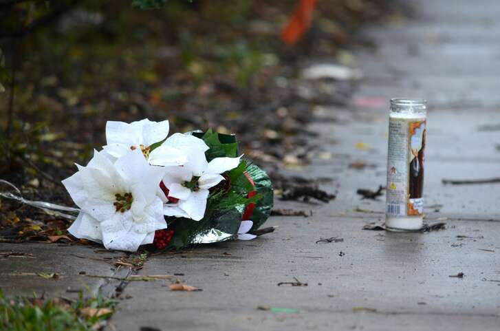 A makeshift memorial sits on the sidewalk the day after teenagers who had been throwing eggs at cars crashed into a pickup truck, killing 45-year-oldSilvia Zavala.