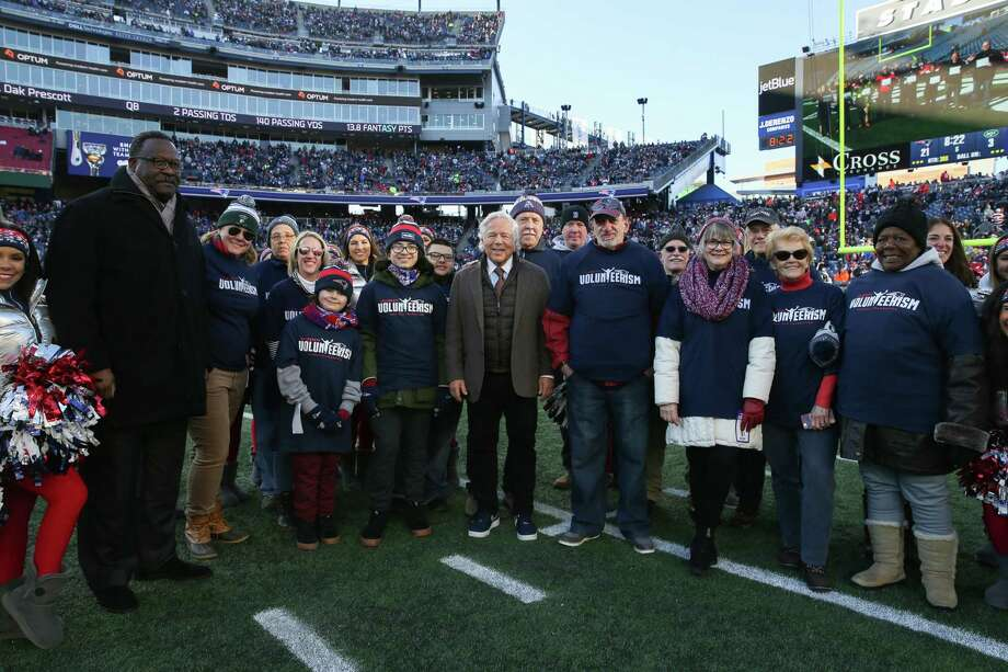 """Patriots Chairman and CEO Robert Kraft and Patriots and Pro Football Hall of Famer Andre Tippett take a group photo with the 2018 Patriots Difference Makers of the Week. Danbury resident Wilda Hayes and Bethel resident Sharon Siegel were among this year's """"Difference Makers."""" Photo: Contributed Photo / Contributed / The News-Times Contributed"""