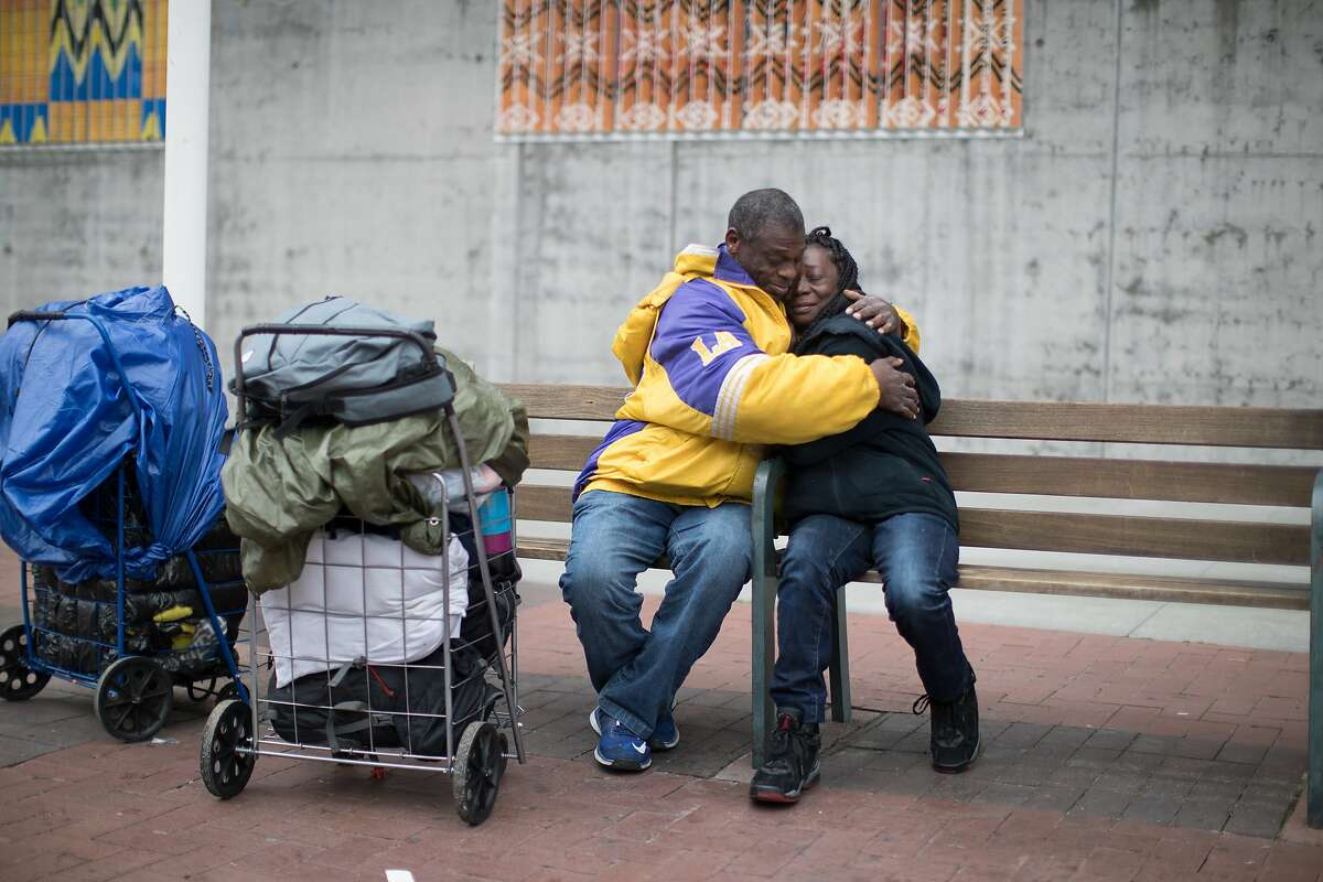 Gregory Dunston Sr. and Marie McKinzie embrace in front of the Amtrak station on Thursday, Dec. 20, 2018, in Oakland, Calif.