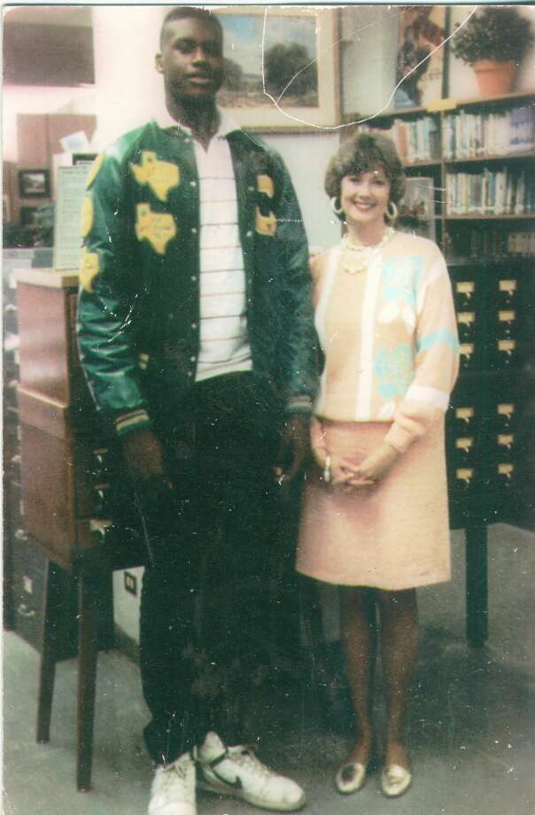"In 1989, shortly after the Cole High School boys basketball team posted a 36-0 record and won the 3A State Championship, Shaquille O'Neal posed with librarian Sandee Mewhinney. ""I knew Shaquille would go far in his basketball career,"" she writes, ""so I wanted a picture with him."" Photo: Courtesy/Mewhinney, Reader Submission"