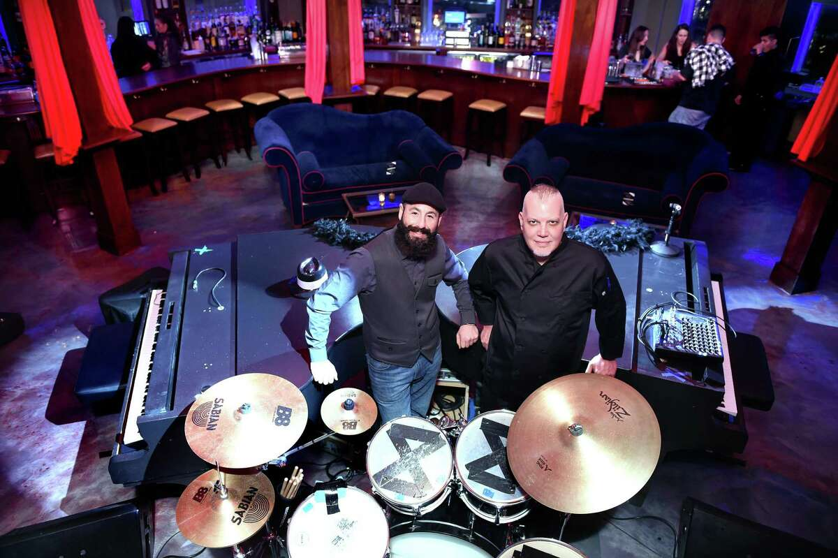 Mickey's Restaurant co-owners, Ari Gorfain, left, and chef Mickey Josephs between two baby grand pianos at Bugsy's Dueling Piano Speakeasy, the event space above Mickey's Restaurant, in Hamden.