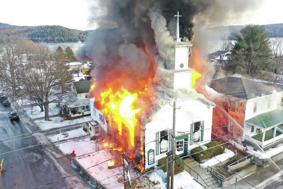 Firefighters are battling a blaze that fully engulfed Schroon Lake Community Church Wednesday afternoon. Photo: Andrew Gushee