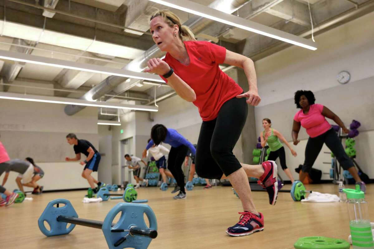 Patricia Downer, of Katy, who works downtown, takes a high-intensity interval training exercise class during a lunch break at the Tellepsen Family Downtown YMCA.