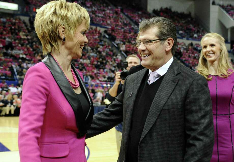 Baylor coach Kim Mulkey, left, and UConn coach Geno Auriemma, greet one another before a game in Hartford on Feb. 18, 2013. Photo: Jessica Hill /Associated Press / FR125654 AP