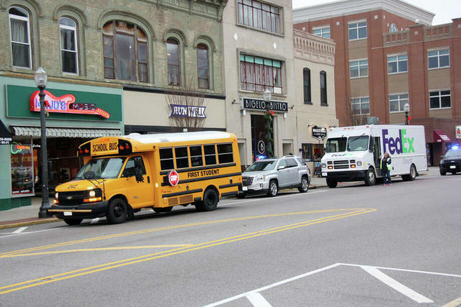 A minor traffic accident occurred on northbound Main St. Wednesday afternoon between a school bus and a FedEx delivery truck in front of Bigelo Bistro. Lt. Charlie Kohlberg of the Edwardsville Police Department said as the school bus drove north on Main, the driver believed an oncoming car came too close, so the bus driver swerved right, causing the bus's passenger side mirror to strike the driver's side mirror on the FedEx truck. Some shrapnel from the mirrors then hit a third vehicle. Kohlberg said no one was injured; the FedEx driver wasn't in the truck at the time and no students were on the bus. Photo: Charles Bolinger | The Intelligencer