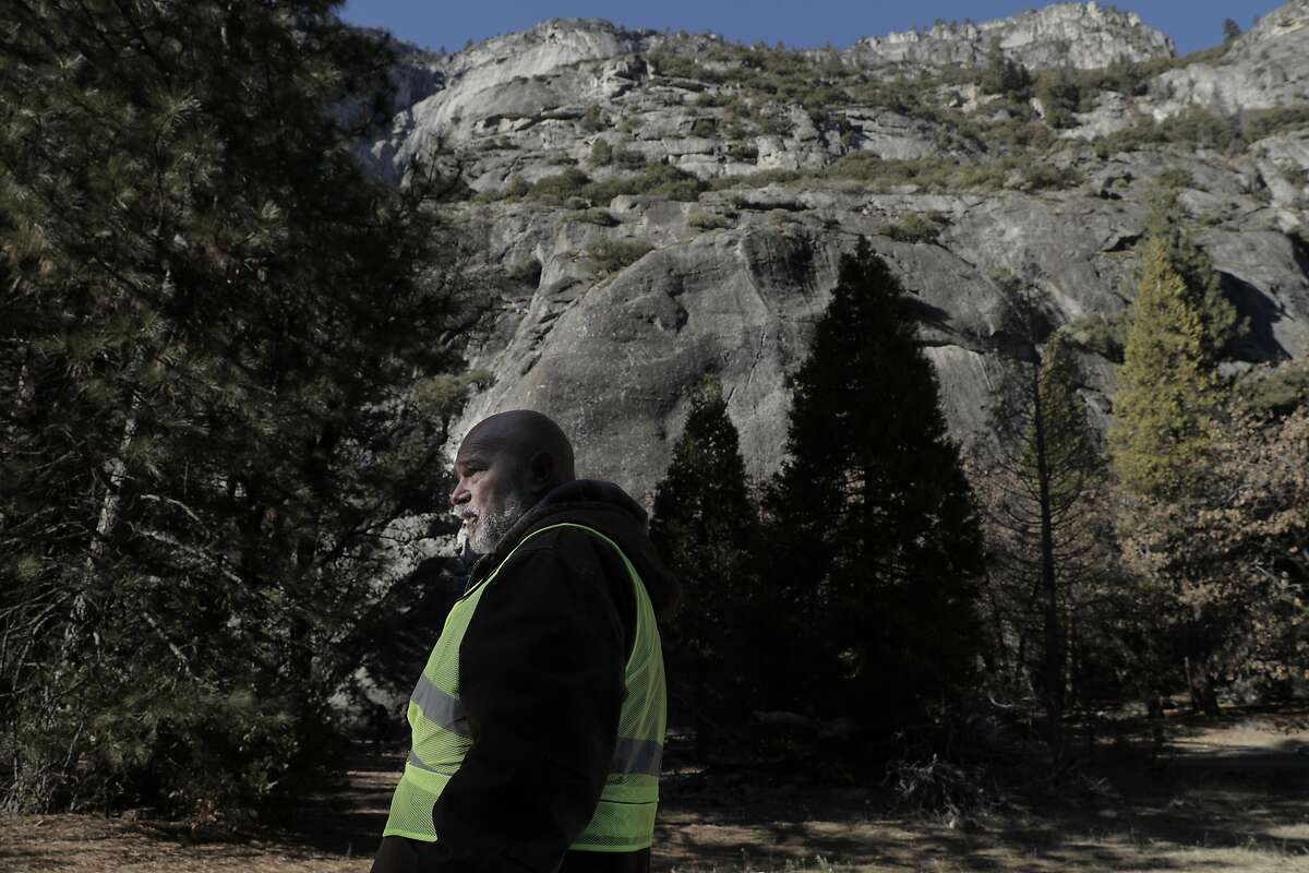 Volunteer Mark Ruter looks for garbage along the roadside as he helps the group Facelift clean up Yosemite during a partial government shutdown that has Yosemite National Park without key services including trash removal and some bathroom services in Yosemite, Calif., on Wednesday, January 2, 2019.