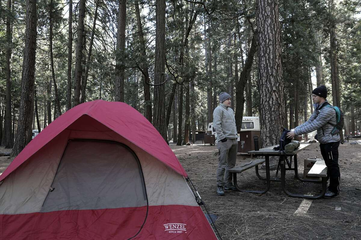 Luke Westby and Lucas Raab camp in Upper Pines Campground in Yosemite during a partial government shutdown that has Yosemite National Park without key services including trash removal and some bathroom services in Yosemite, Calif., on Wednesday, January 2, 2019.
