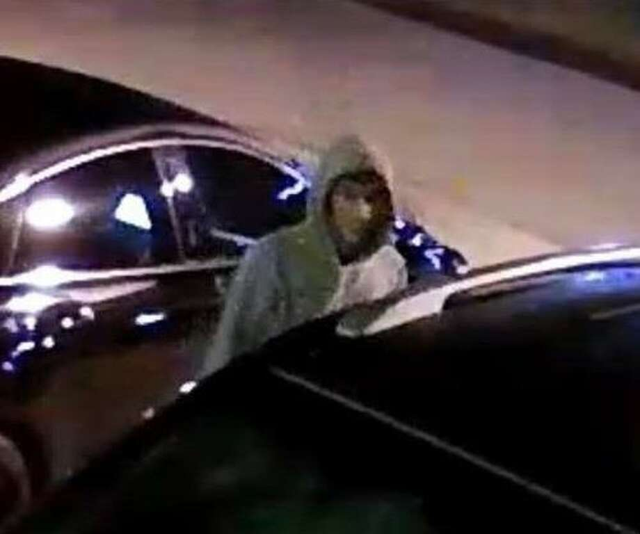 A man is seen in surveillance footage in Magnolia. Montgomery County Sheriff's Office deputies say the suspect is one of three men who were burglarizing vehicles in the area, stealing multiple firearms. Photo: MCSO