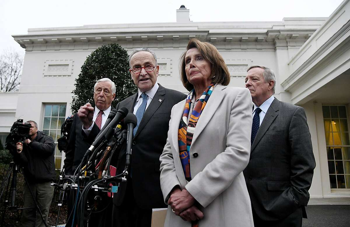 Democratic Congressional leaders, including House Speaker Nancy Pelosi and Senate Minority Leader Chuck Schumer, speak outside the West Wing of the White House after meeting with President Donald Trump to end the shutdown on Wednesday, Jan. 2, 2019 in Washington, D.C. (Olivier Douliery/Abaca Press/TNS)