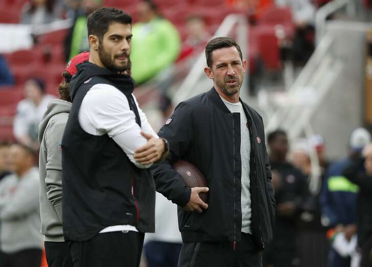 Injured San Francisco 49ers quarterback Jimmy Garoppolo, left, and head coach Kyle Shanahan watch players warm up before an NFL football game against the Seattle Seahawks in Santa Clara, Calif., Sunday, Dec. 16, 2018. (AP Photo/Tony Avelar)