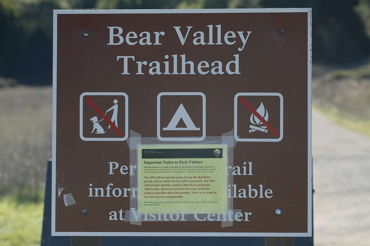 A notice is posted at the Bear Valley Trailhead advising of the limited services available at Point Reyes National Seashore in Olema, Calif. on Wednesday, Jan. 2, 2019.
