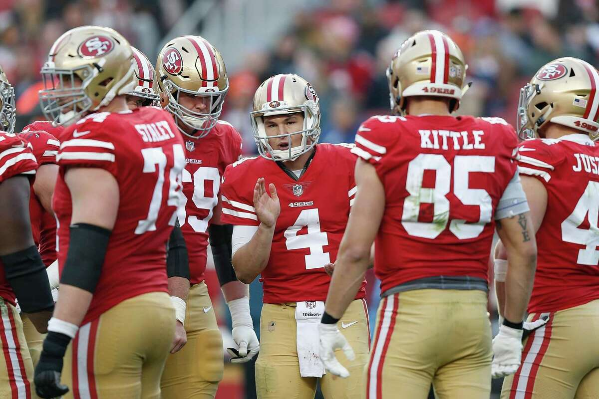 Quarterback Nick Mullens of the San Francisco 49ers calls a play in the huddle during the game against