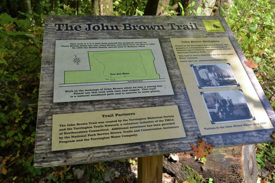 A trail marker for John Brown's birthplace in 1800 near University Drive. Below, a Photo: Leslie Hutchison / Hearst Connecticut Media /