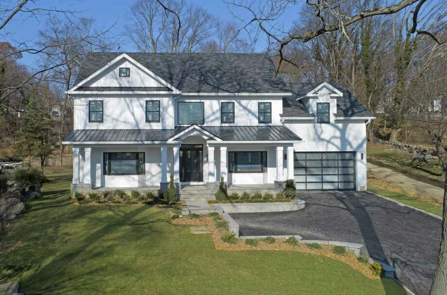 This 2018-constructed home at 66 Halsey Drive in Old Greenwich is listed for $2.45 million by Berkshire Hathaway HomeServices, New England Properties. Located on a 0.49-acre lot, the brand new home offers five bedrooms and more than 5,300 square feet of living space. Photo: Berkshire Hathaway HomeServices / ONLINE_CHECK