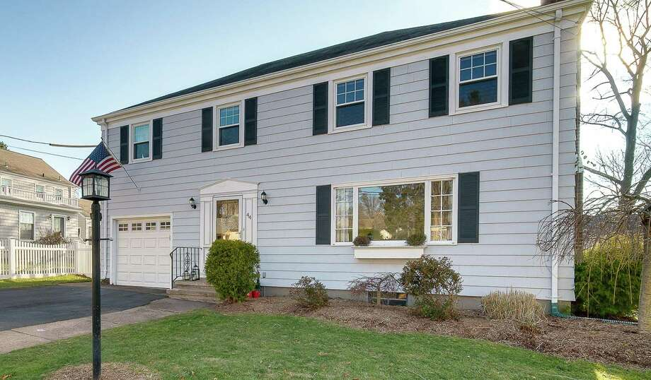 This beautifully updated four bedroom colonial is ideally located in the heart of Spring Glen, walking distance to the village, schools and park. Photo: Press|Cuozzo Realtors / ONLINE_CHECK