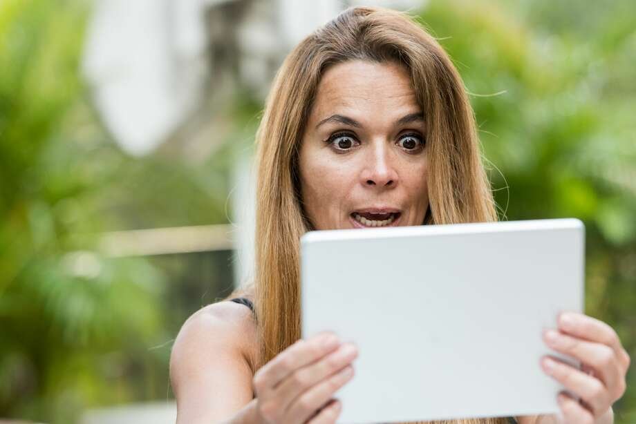 Her son in law gave her his old tablet but when she opened it she soon realized he had dating apps. Should she tell her daughter?  Photo: Juanmonino/Getty Images/iStockphoto