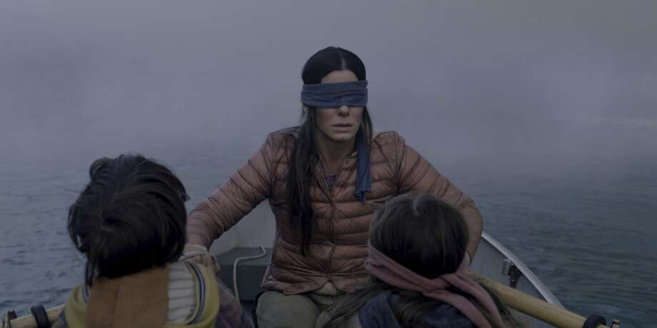 """FILE- This file image released by Netflix shows Sandra Bullock in a scene from the film, """"Bird Box."""" Netflix lifted the usually tightly sealed lid on its viewership numbers in a recent tweet that disclosed 45 million subscriber accounts had watched the thriller, """"Bird Box,"""" during its first seven days on the service. That made the film the biggest first-week success of any movie made so far for Netflix's 12-year-old streaming service. (Merrick Morton/Netflix via AP, File) Photo: Merrick Morton, Associated Press"""