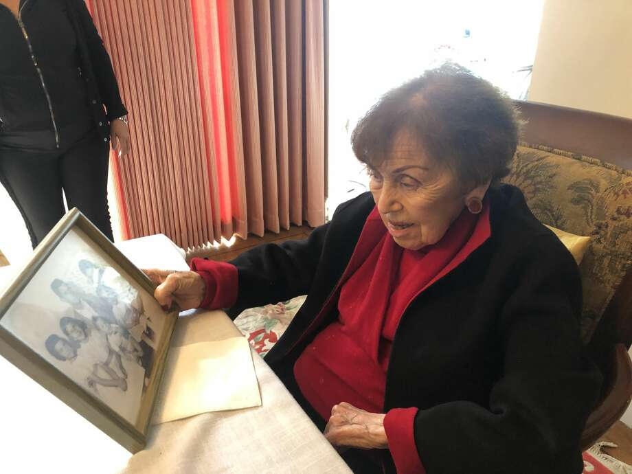 Ruth Mellinger, 100, holds an old family photograph in her Ingleside home on December 3, 2018. Photo: Michelle Robertson/SFGATE