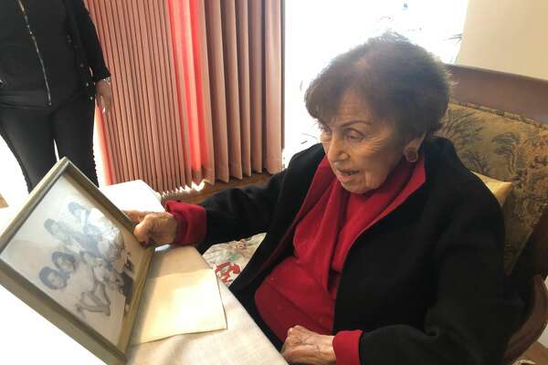 Ruth Mellinger, 100, holds an old family photograph in her Ingleside home on December 3, 2018.