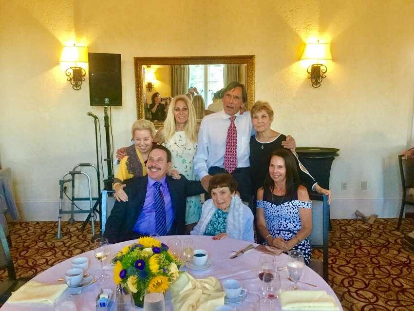 Ruth Mellinger (center, bottom row) celebrates her 100th birthday on August 16, 2018, with her six children: Steve Mellinger, Terry Wyrsch (front row, L-R), Mary Sullivan, Nancy Warner, Randy Mellinger, Kathy Hebert (back row, L-R).
