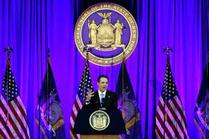 New York Gov. Andrew Cuomo delivers his third inaugural address, on Ellis Island in New York harbor, Tuesday, Jan. 1, 2019. (AP Photo/Richard Drew)