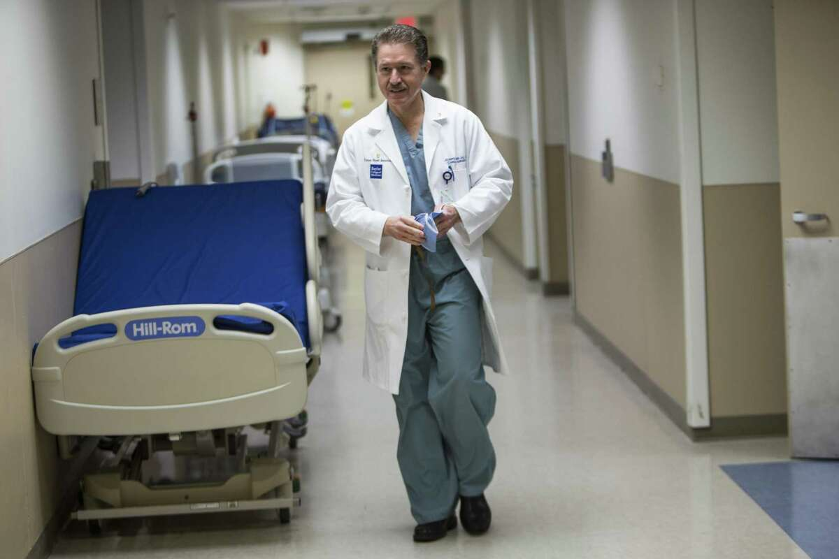 Dr, Joseph Lamelas walks to the operating room before performing heart surgery at Baylor St. Luke's Hospital on Thursday, March 2, 2017, in Houston. Lamelas is a pioneer in minimally invasive cardiac surgery. Lamelas left Houston in late 2018 to return to Miami, where he will be chief of cardiothoracic surgery at the University of Miami Health System.