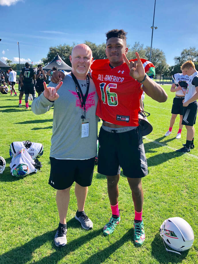 Port Neches-Groves head coach Brandon Faircloth signals horns up with PN-G's all-time passing leader and Texas commit Roschon Johnson at practice for the Under All-American game. Photo: Special To The Enterprise