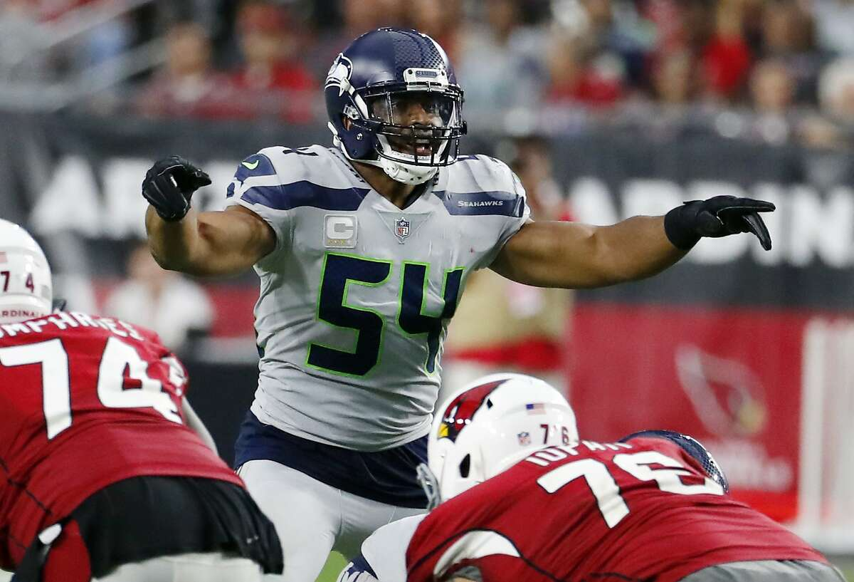FILE - In this Sept. 30, 2018, file photo, Seattle Seahawks linebacker Bobby Wagner (54) gestures at the line of scrimmage during an NFL football game against the Arizona Cardinals in Glendale, Ariz. Seattle's Bobby Wagner and Sean Lee of Dallas were the All-Pro leaders of their defenses at linebacker the previous time the Seahawks and Cowboys made the playoffs.Little has changed for Wagner's group in two years. Not much is the same for the middle of the Dallas defense going into the first postseason meeting between the teams since the 2006 season.. (AP Photo/Rick Scuteri, File)