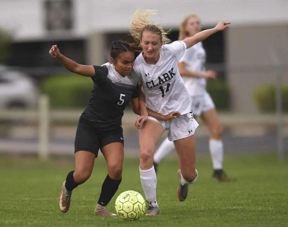 Steele's Feli Montoya (5) and Jessica Quinn (14) of Clark chase down the ball during UIL Class 6A bi-district girls high school soccer action at the Blossom Soccer Stadium West Field on Wednesday, March 28, 2018. Photo: Billy Calzada, Staff / San Antonio Express-News / San Antonio Express-News