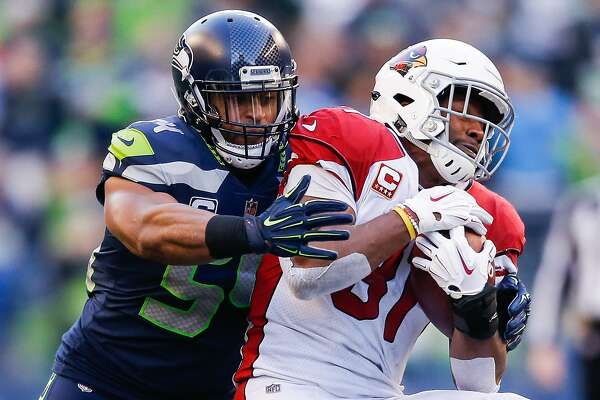 SEATTLE, WA - DECEMBER 30: Bobby Wagner #54 of the Seattle Seahawks tackles David Johnson #31 of the Arizona Cardinals in the third quarter at CenturyLink Field on December 30, 2018 in Seattle, Washington. (Photo by Otto Greule Jr/Getty Images)