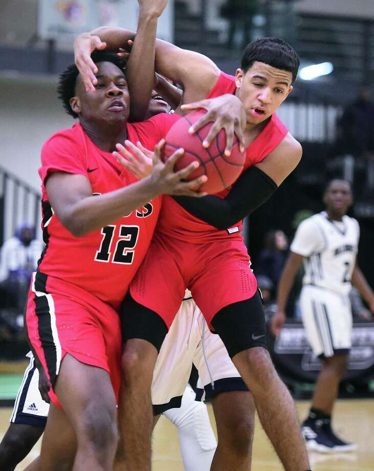 Terrance Edwards (left) and Kyle Daniels of Wilbur Cross grab a rebound against Hillhouse in the first half at the Floyd Little Athletic Center in New Haven on Wednesday. Photo: Arnold Gold / Hearst Connecticut Media / New Haven Register