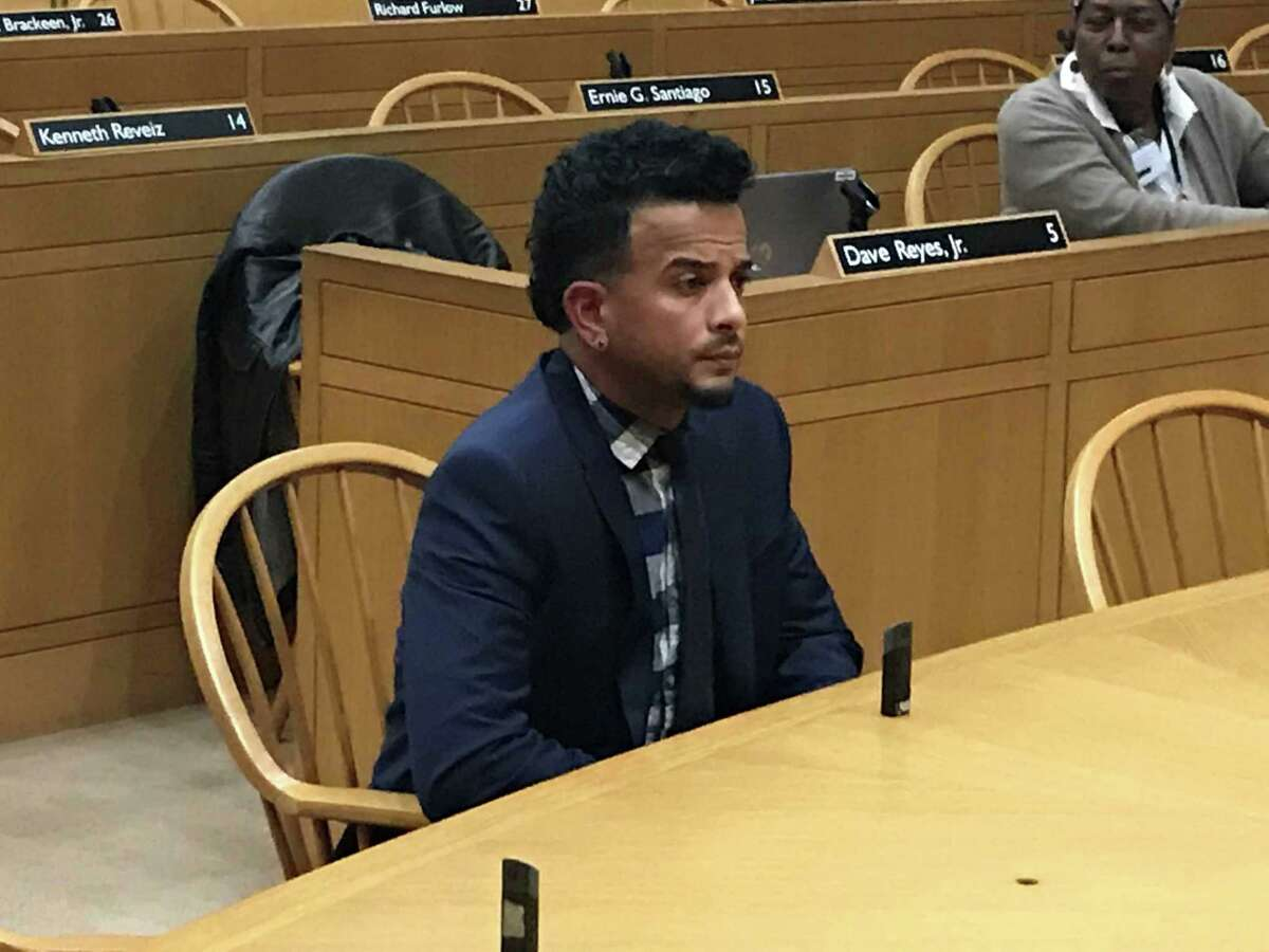 Jamell Cotto testifies before the Board of Alders' Aldermanic Affairs Committee Wednesday in New Haven.