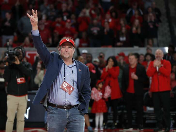 New Houston Football head coach Dana Holgorsen waves to the crowd during halftime of an NCAA Men's basketball game at Feritta Center, Wednesday, Jan. 2, 2019, in Houston.