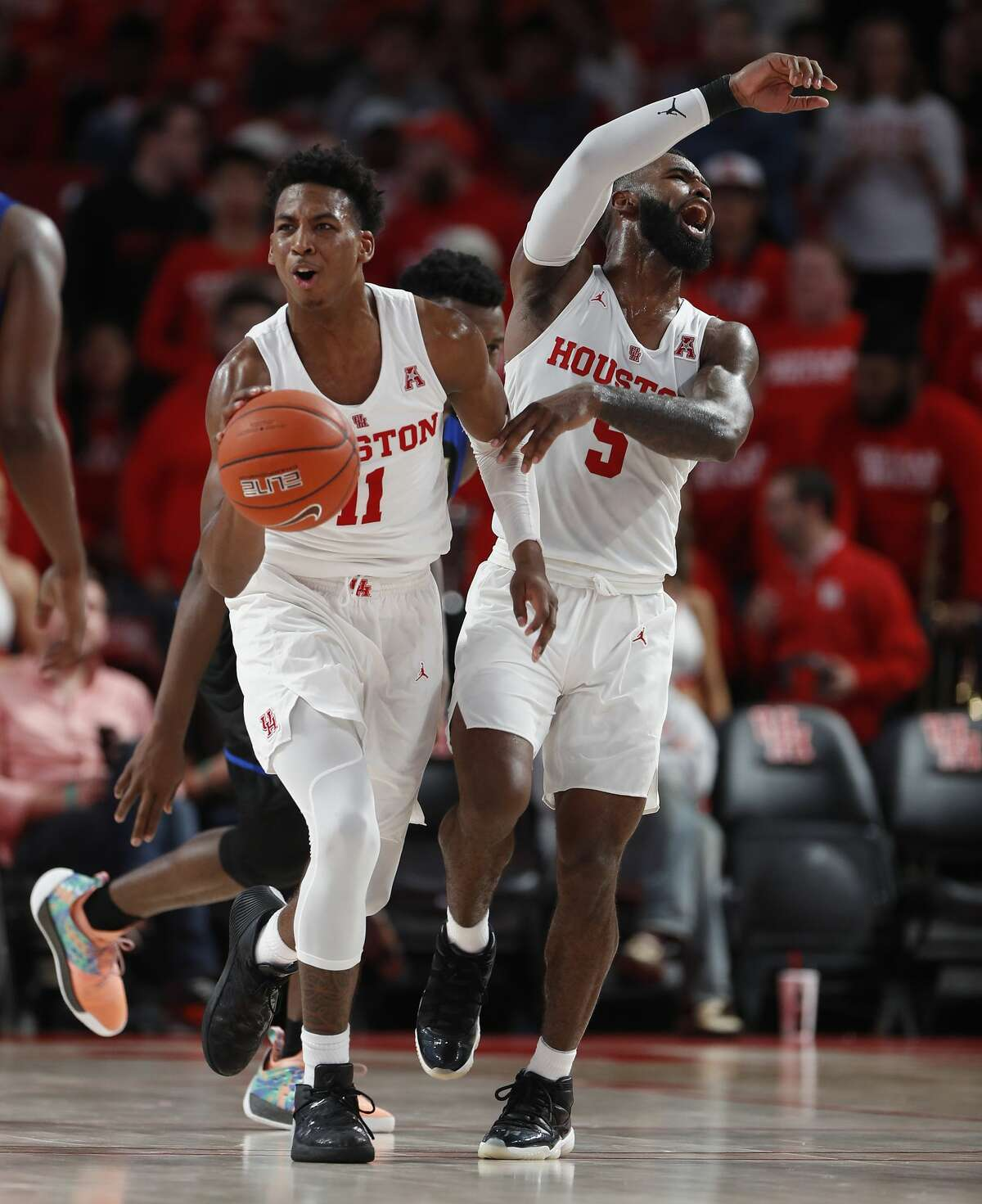 Houston Cougars guards Nate Hinton (11) and Corey Davis Jr. (5) react after a foul was called during the second half of an NCAA Men's basketball game at Feritta Center, Wednesday, Jan. 2, 2019, in Houston.