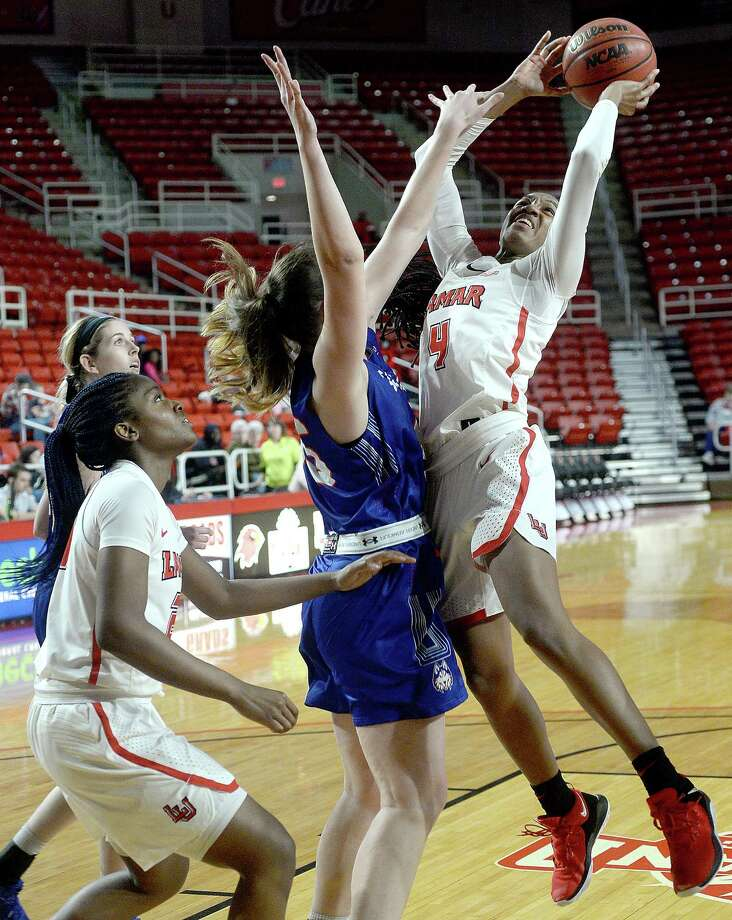 Lamar's Briana Laidler puts up her shot against Houston Baptist's Veronika Kirienko during the Lady Cardinals' Southland Conference home opener Wednesday. 