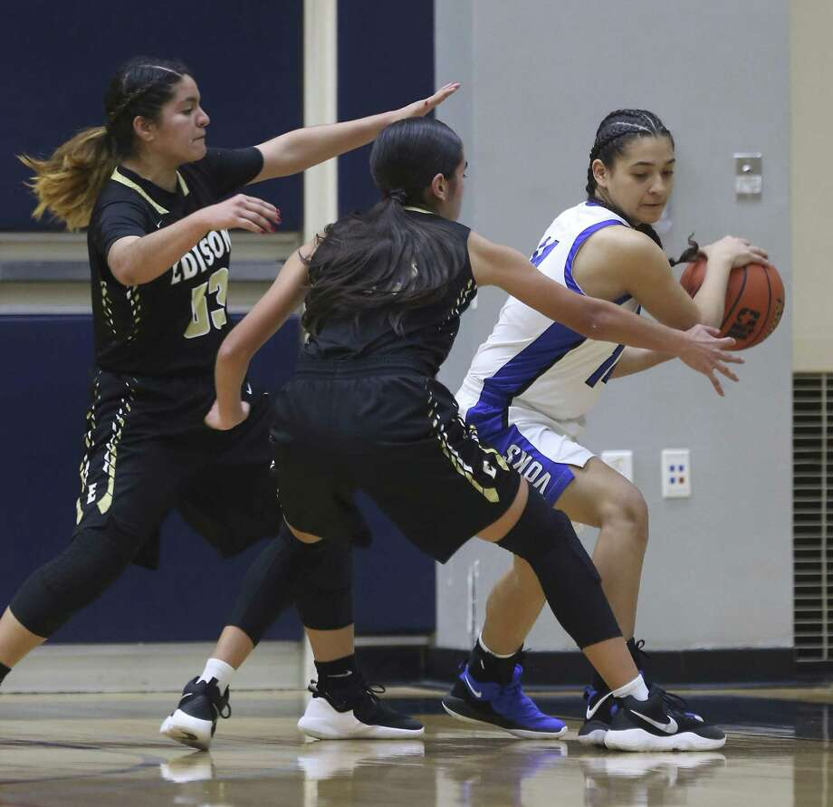 Lanier's Abigail Chamberlain, right, tries to pass Wednesday, Jan. 2, 2019 while under pressure from Edison's Jazlyn Balderas, left, and Madylynn Zavala during the Voks' game against the Golden Bears at the Alamo Convocation Center. Photo: William Luther, Staff / San Antonio Express-News / © 2019 San Antonio Express-News