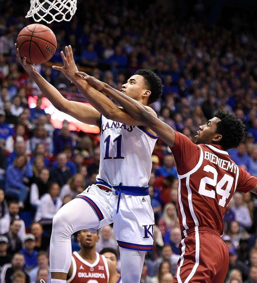 Kansas' Devon Dotson streaks past Oklahoma's Jamal Bieniemy for a bucket during the first half at Allen Fieldhouse in Lawrence, Kan. Photo: Rich Sugg / TNS
