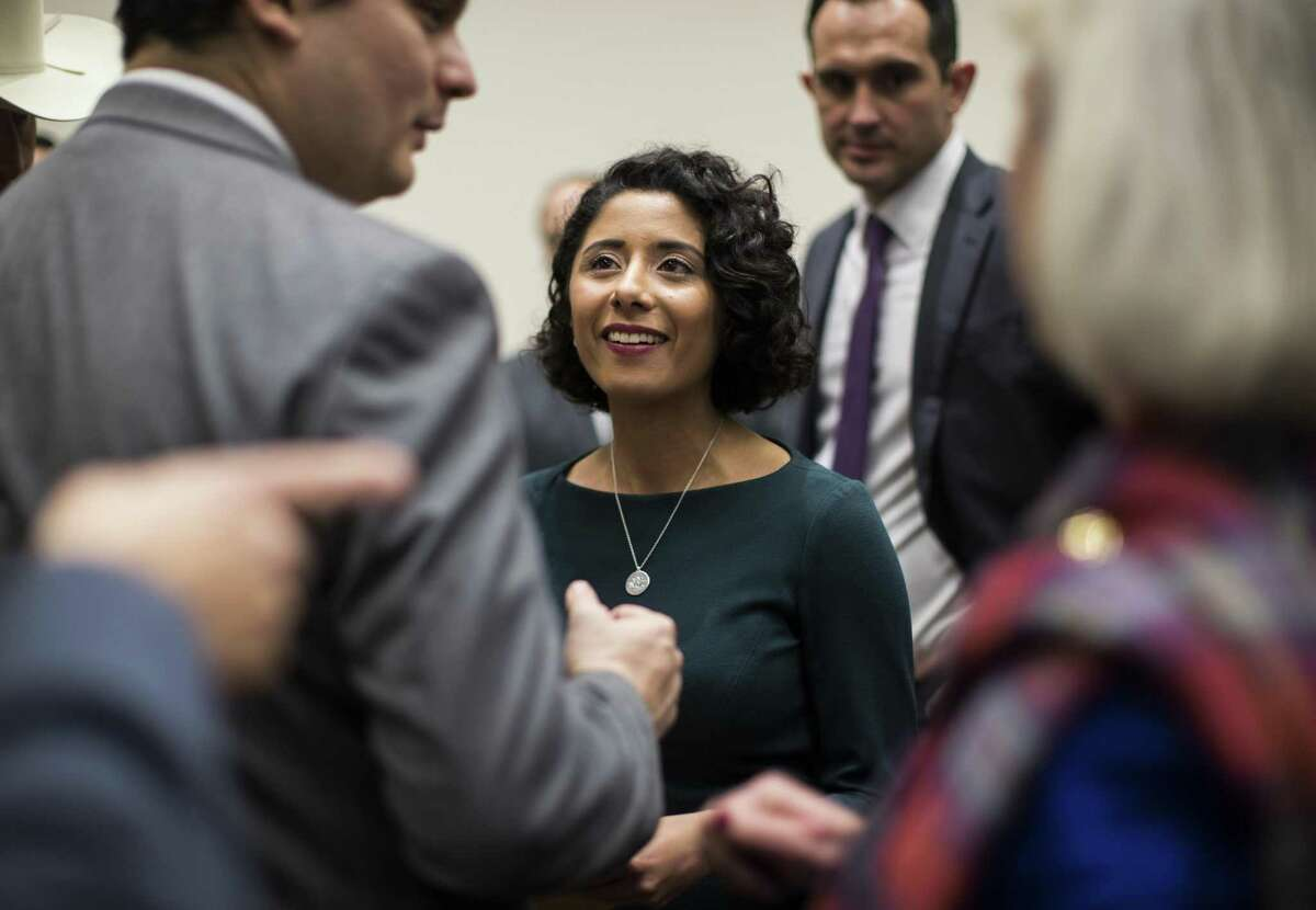 After being sworn in, Harris County judge Lina Hidalgo engages with people wanting to wish her well after the Harris County Swearing-In Ceremony and Celebration at the NRG Center on Tuesday, Jan. 1, 2019, in Houston.