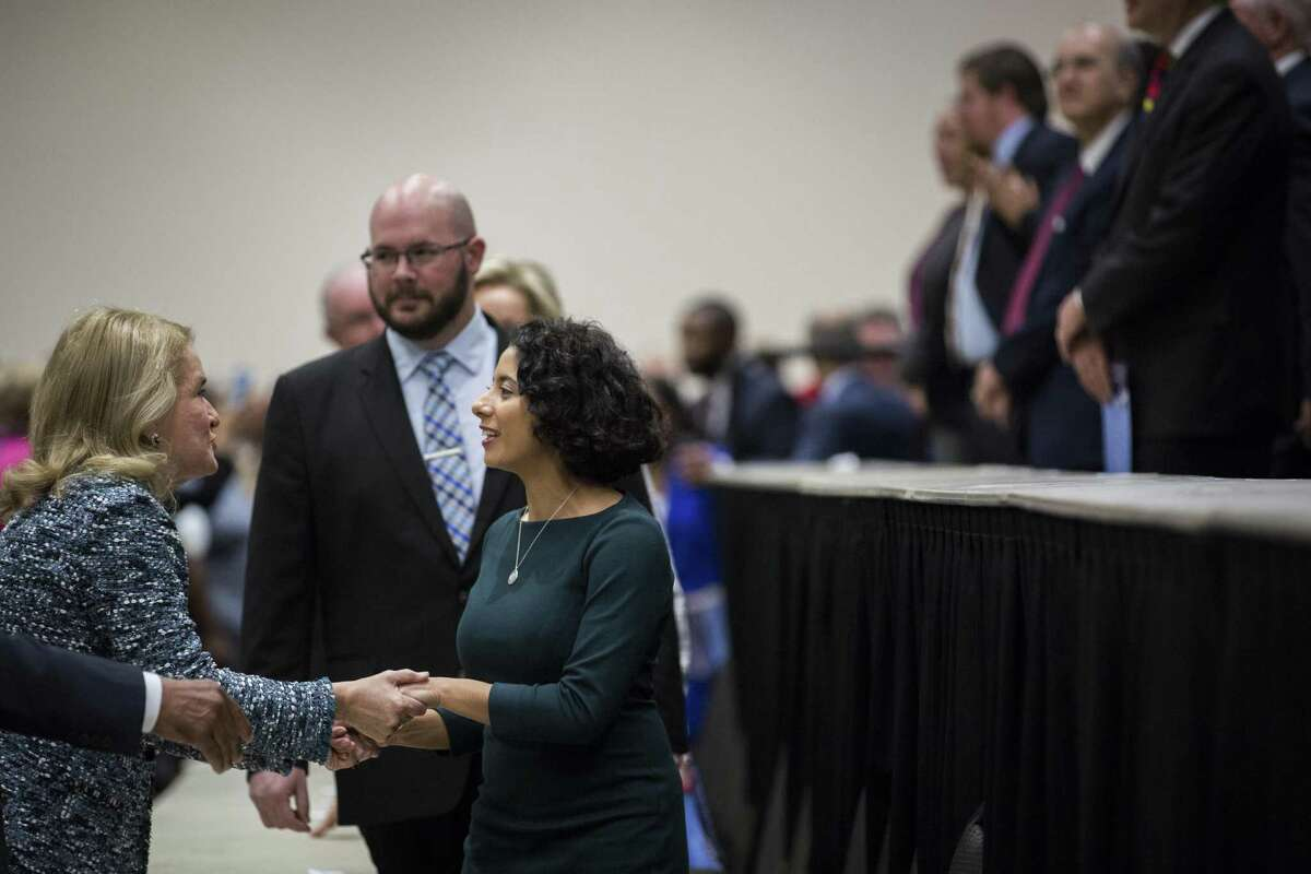 Newly elected Harris County judge Lina Hidalgo, right, and newly elected U.S. Rep. Sylvia Garcia, left, shake hands as Hidalgo enters the stage along with other newly sworn in Harris County officials during the Harris County Swearing-In Ceremony and Celebration at the NGR Center on Tuesday, Jan. 1, 2019, in Houston.