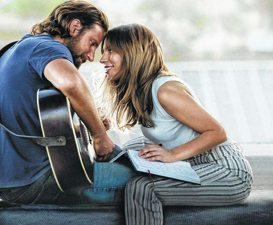 "Bradley Cooper and Lady Gaga share a scene in ""A Star is Born."" Cooper's directing debut was ranked among the best — and most popular — films of 2018. Photo: Warner Bros. Pictures Via AP"