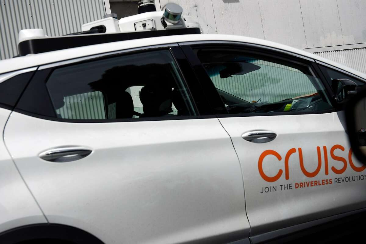 A Cruise Automation autonomous car drives down a street in San Francisco, Calif., Friday March 30, 2018.