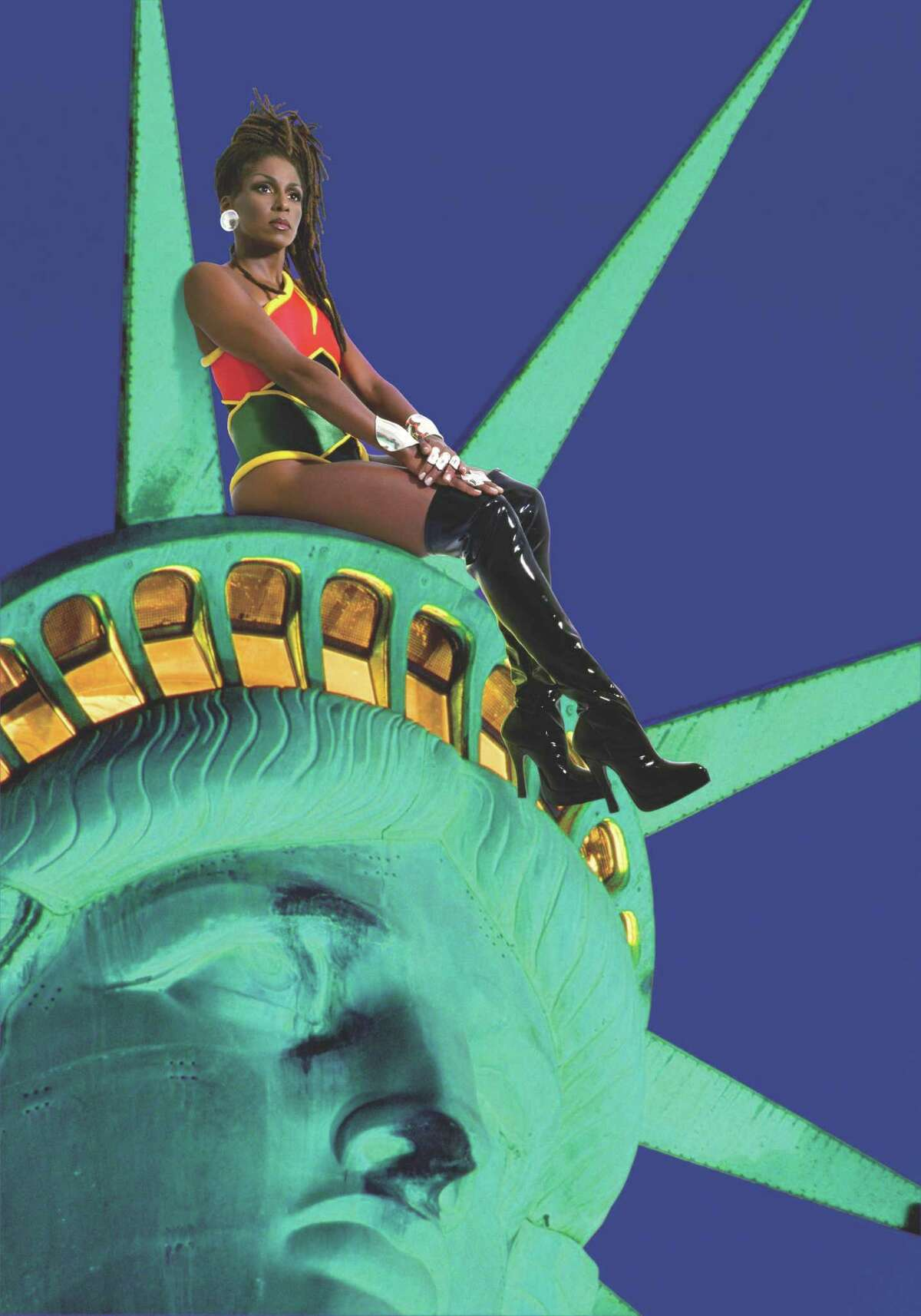 """Renée Cox' """"Chillin' with Liberty,"""" a 1998 Cibachrome print, is one of two images from Cox' Rajé series in which she depicts a superhero of her own devising included in """"Men of Steel, Women of Wonder,"""" the big summer show at the San Antonio Museum of Art."""