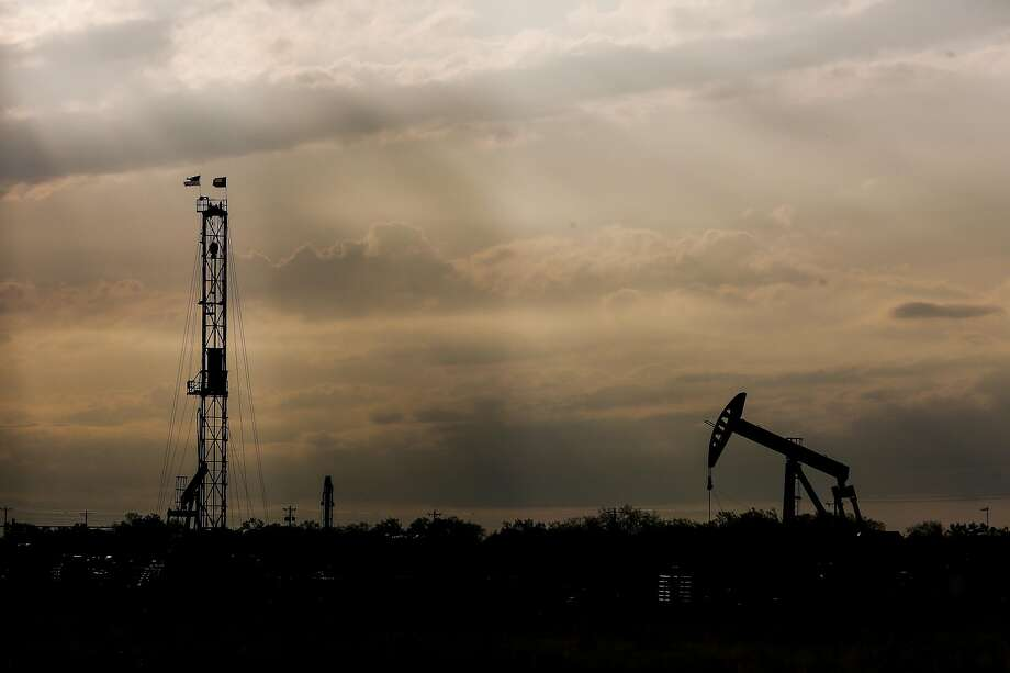 A drilling rig and pump jack sit on the Donnell Ranch Tuesday, May 23, 2017 in Tilden, the county seat of McMullen County.  NEXT: See recent earnings reports from Houston-area energy companies. Photo: Michael Ciaglo, Houston Chronicle