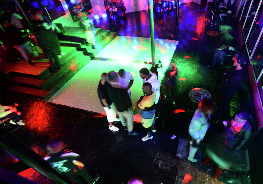 Guests mingle at the Safari Nightclub in downtown Beaumont on Friday. The former Copa nightclub, the establishment opened for business on Friday.  Photo taken Friday, 12/28/18 Photo: Guiseppe Barranco/The Enterprise / Guiseppe Barranco ?