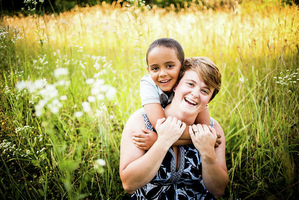 """Smiling brightly with her son is SIUE's Anni Reinking, EdD, assistant professor in the School of Education, Health and Human Behavior's Department of Teaching and Learning, and author of """"Not Just Black and White."""""""