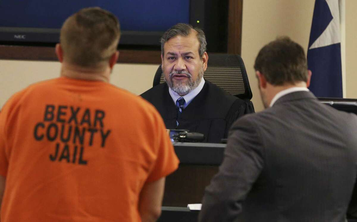 Judge Ron Rangel of 379th District Court in Bexar County, shown during a hearing this month, was instrumental in assurance more counsel at bail hearings for indigent defendants.