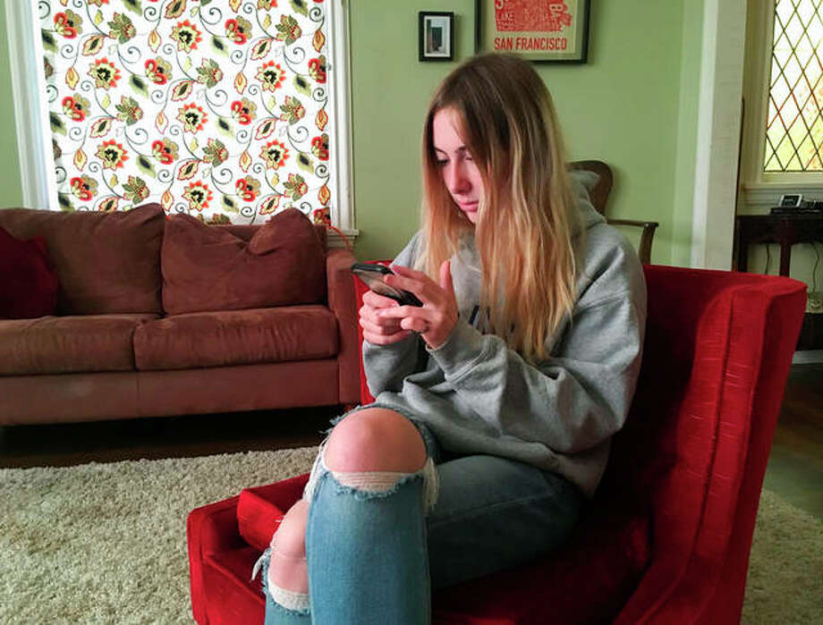Laurel Foster is among teens involved in Stanford University research testing whether smartphones can be used to help detect depression and potential self-harm. Haven Daley | AP