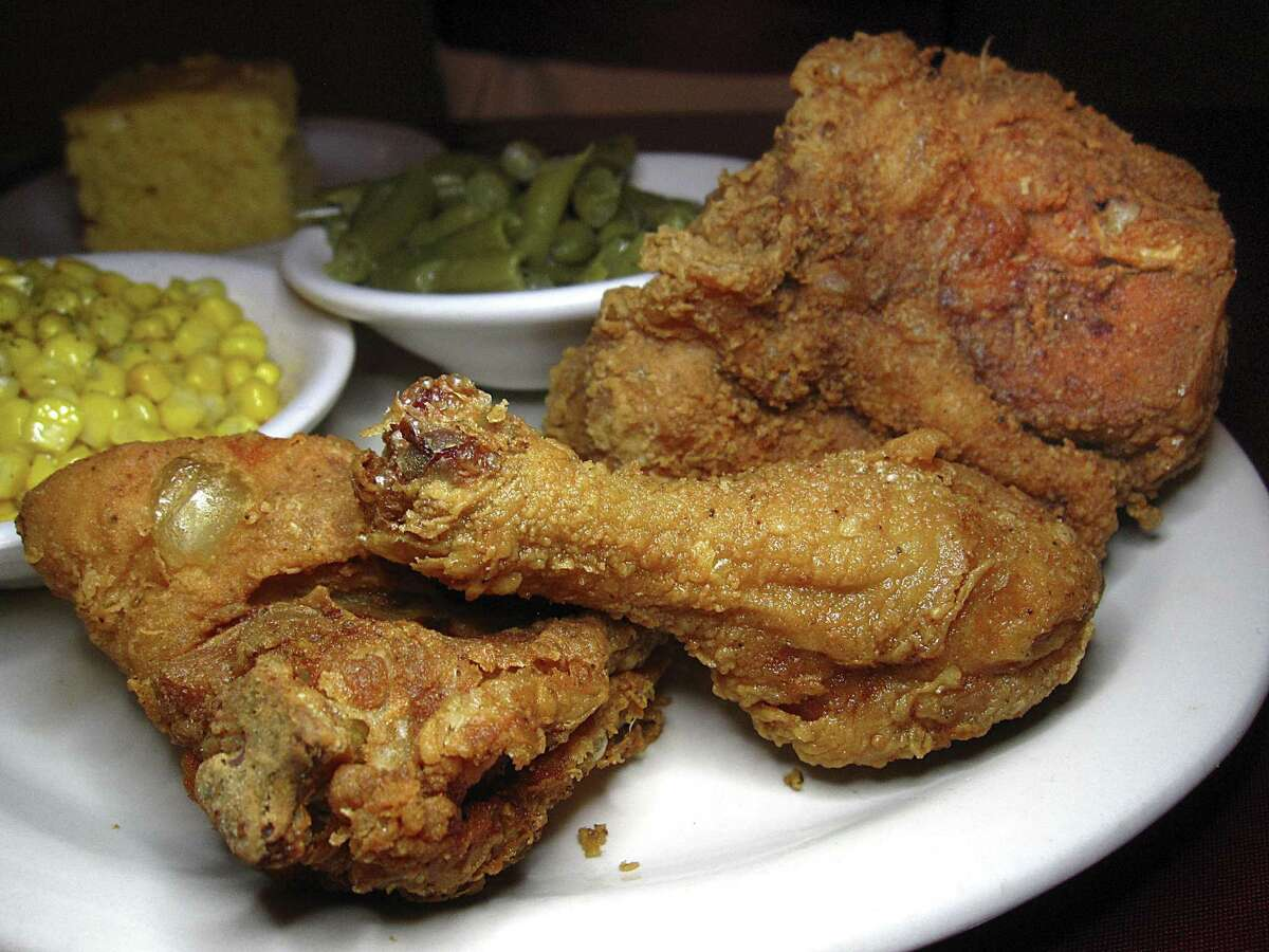 Fried chicken with cornbread and sides of corn and green beans from Mrs. Kitchen Soul Food Restaurant