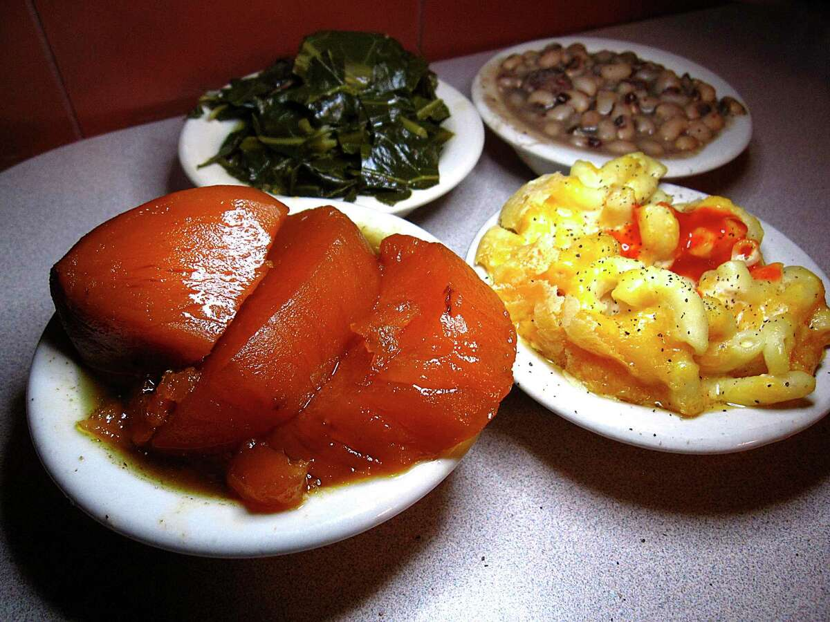 Candied yams, foreground, collard greens, black-eyed peas and macaroni and cheese from Mrs. Kitchen Soul Food Restaurant