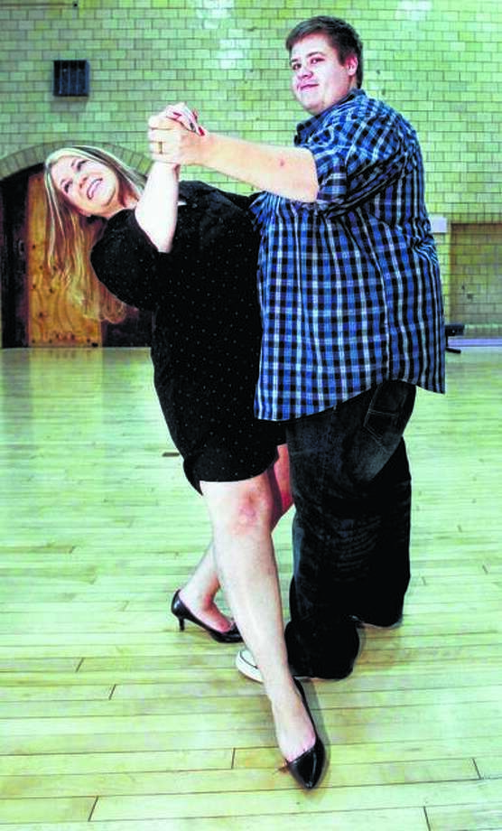 A couple, pictured, learns some new moves at Edwardsville at Live Love Dance. The group welcomes the public to learn Salsa and Tango on Thursday nights. Six classes will begin on Valentine's Day and continue through March 28, with a break on March 7. Photo: For The Intelligencer
